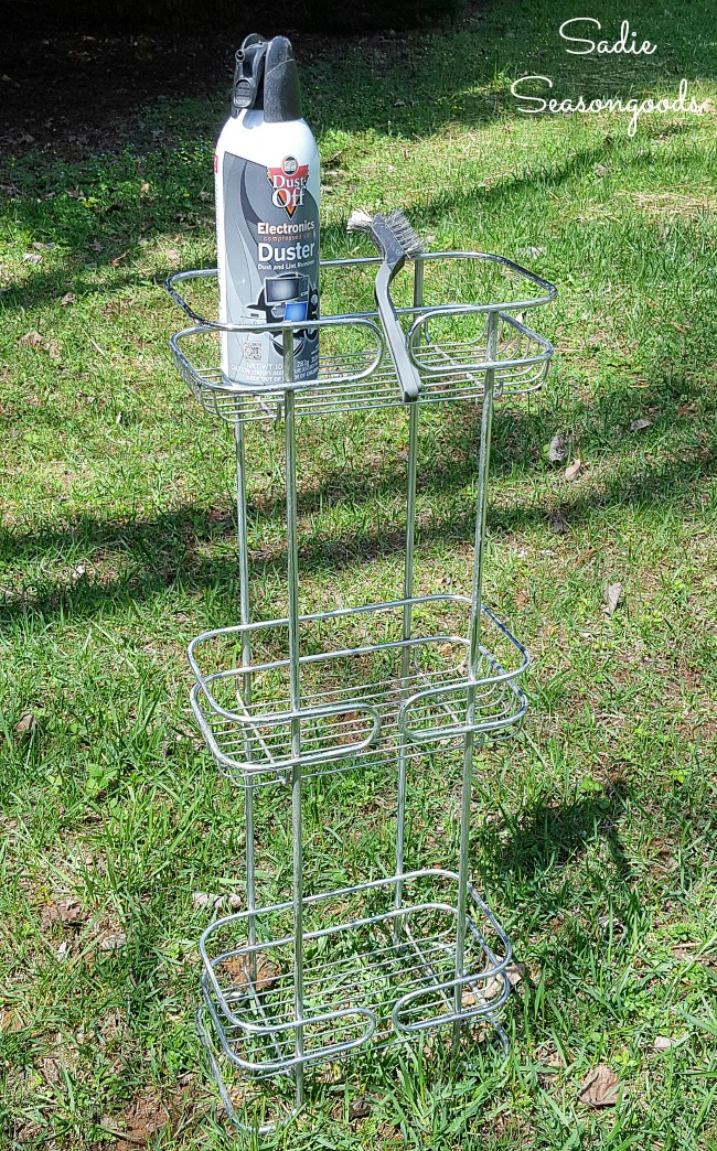 Cleaning a standing shower caddy with a wire brush before spray painting metal