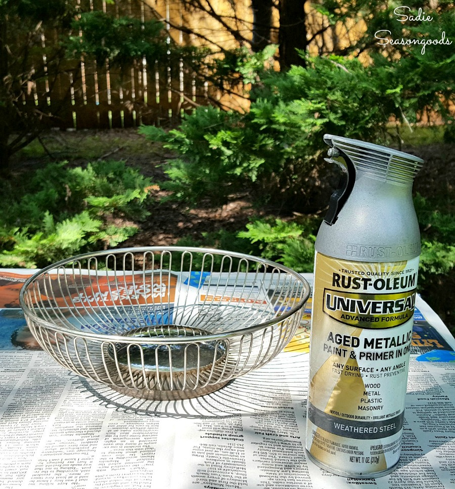 Using Rustoleum Weathered Steel spray paint on metal basket to transform it into a farmhouse bowl by Sadie Seasongoods