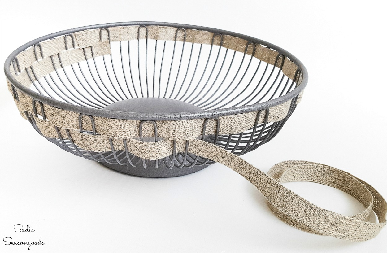 Farmhouse wire basket with burlap ribbon and a bread basket