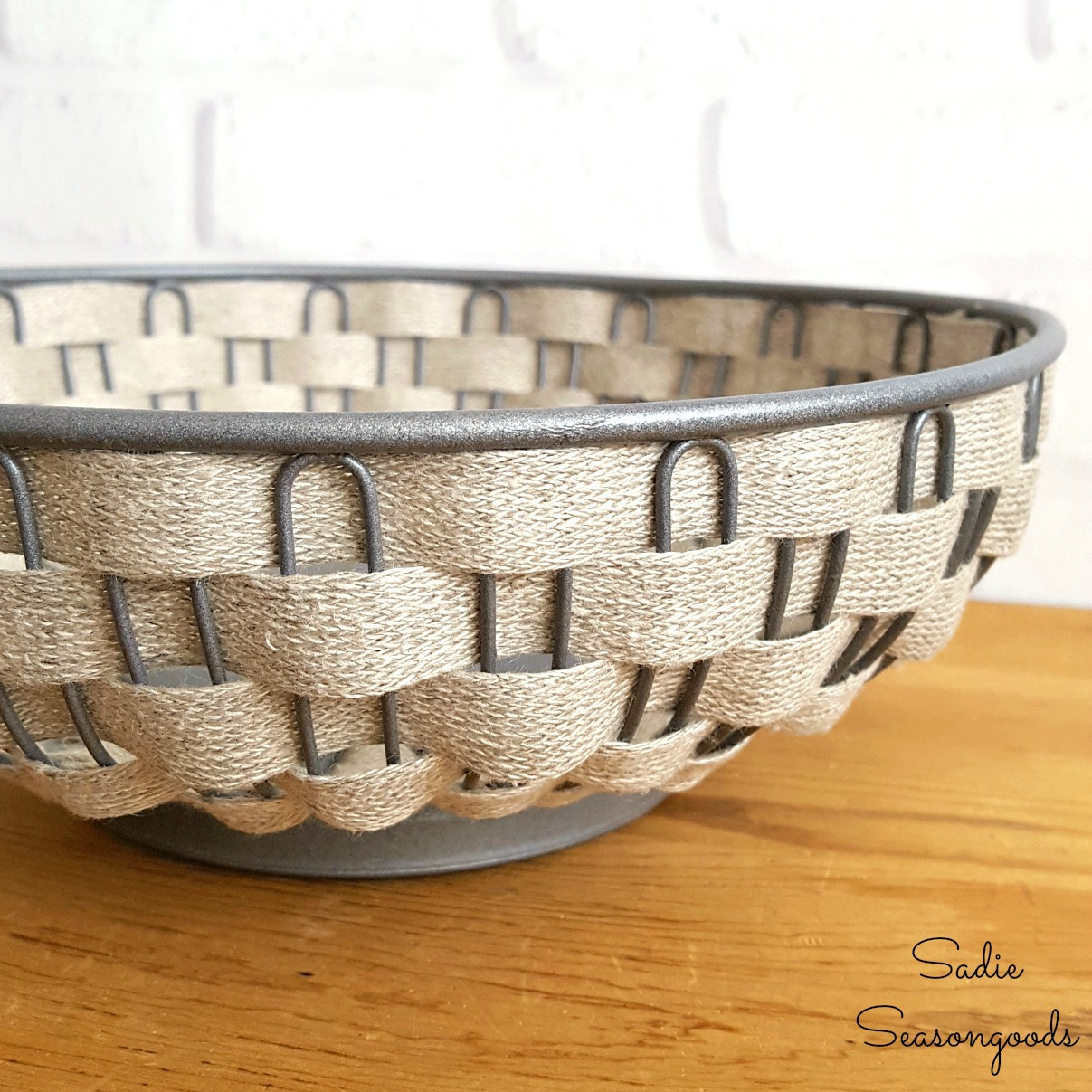 Rustic decor and farmhouse bowl with wire baskets and burlap ribbon as a thrift store makeover