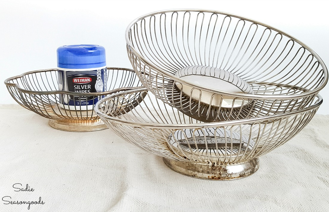 Silver wipes on wire bread baskets before upcycling with galvanized spray paint