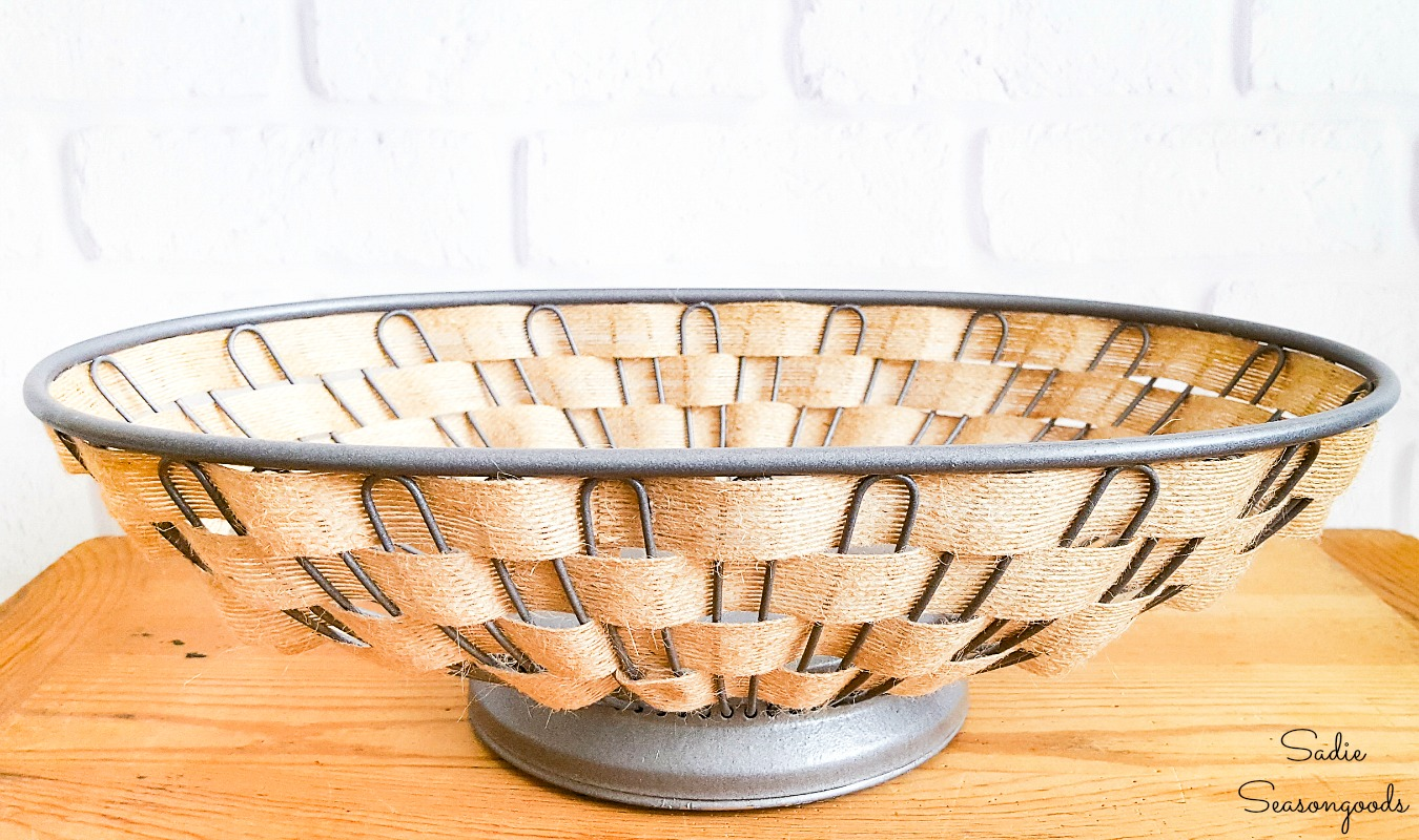 Upcycling a bread basket with galvanized spray paint and farmhouse ribbon