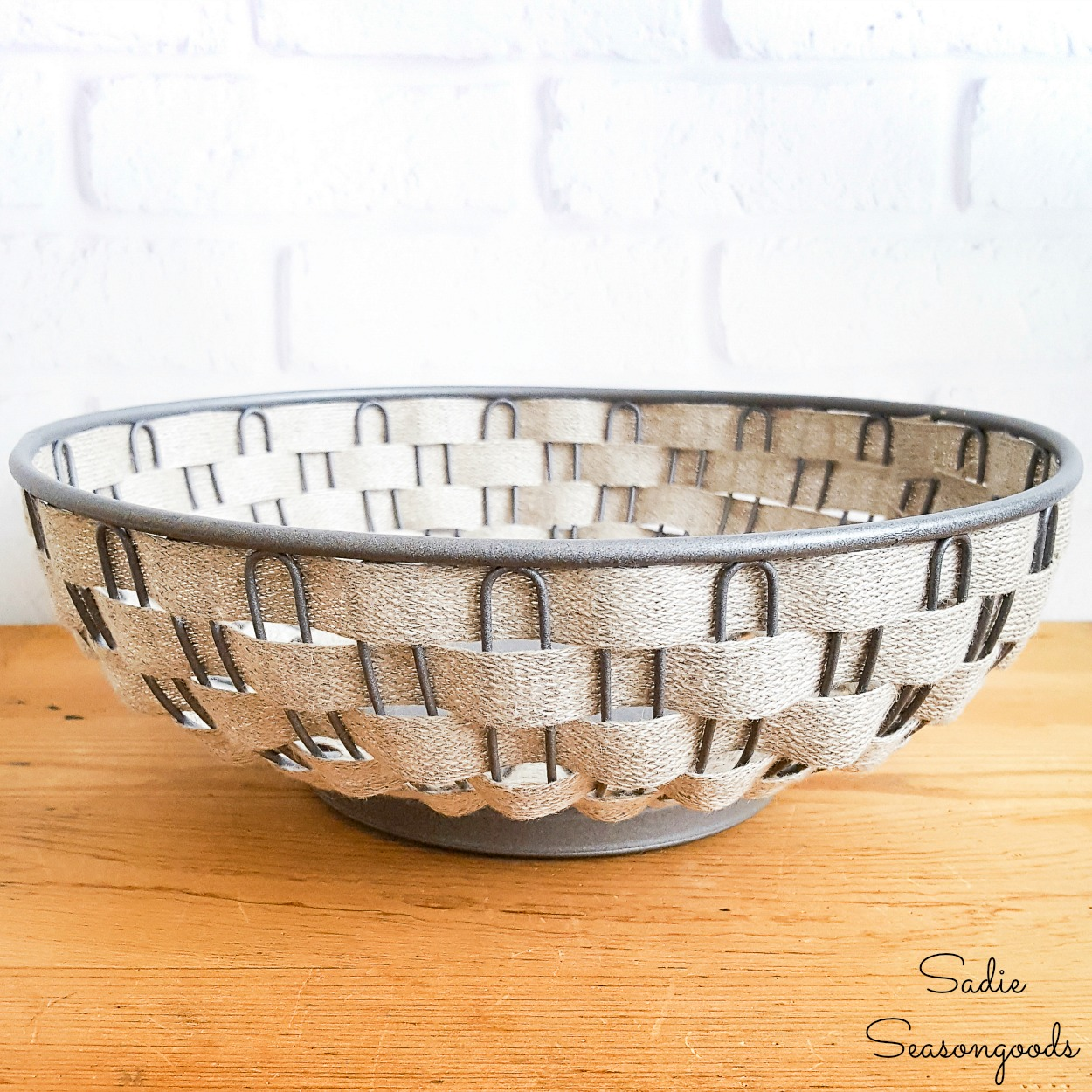 Vintage farmhouse decor with a wire bread basket and galvanized spray paint