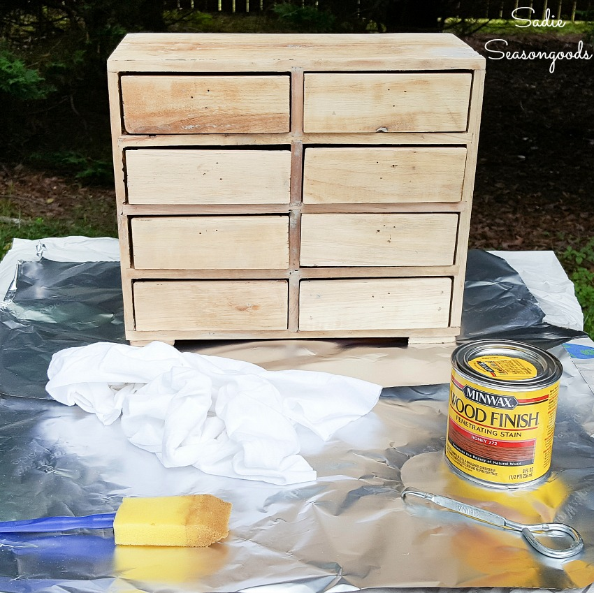 Honey wood stain on a DIY card catalog from a mini chest of drawers