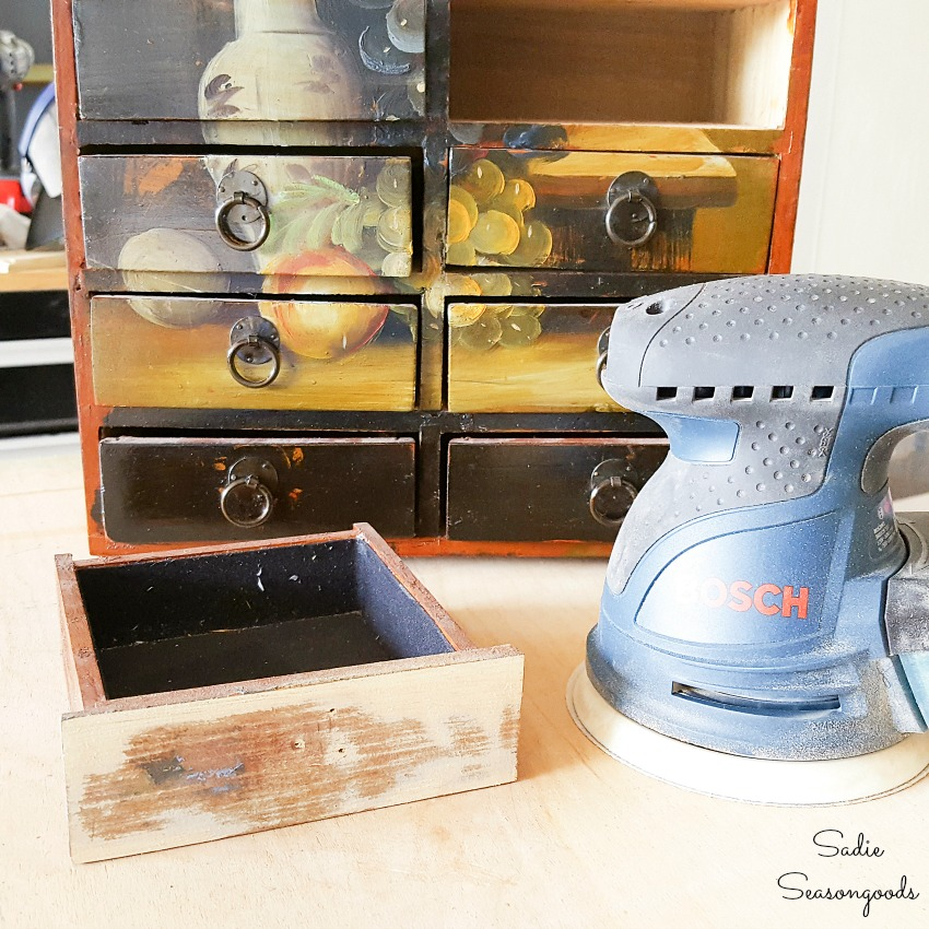 Using a Bosch orbital sander to remove paint from wood furniture