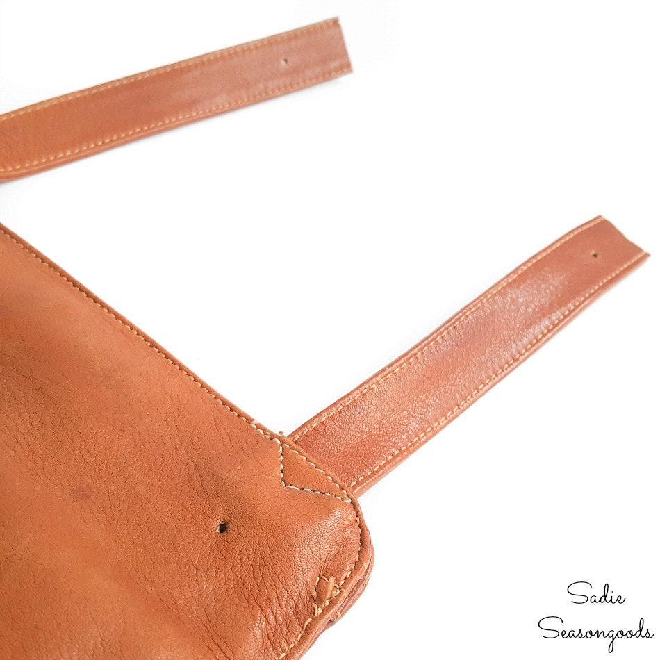 Holes in a leather hip bag for rapid rivets
