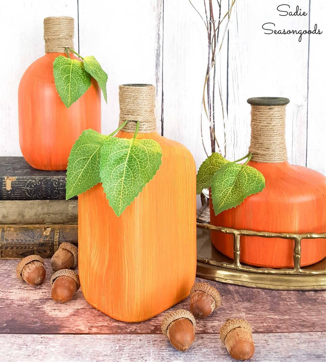 fall pumpkin decor with liquor bottle crafts