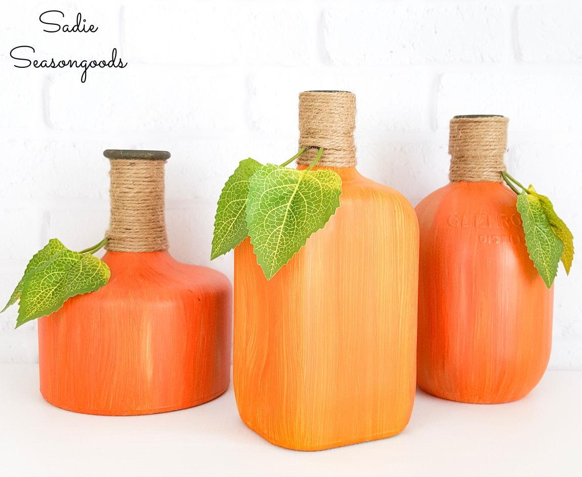 glass pumpkins by liquor bottle painting