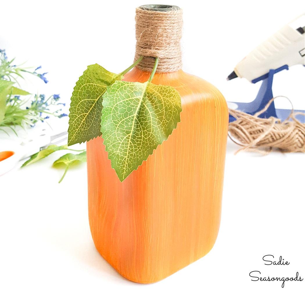 pumpkin decor from a glass bottle