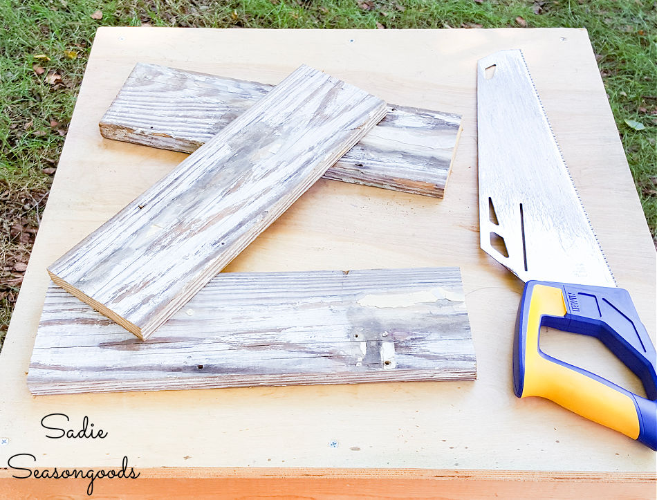 sawing the reclaimed wood planks