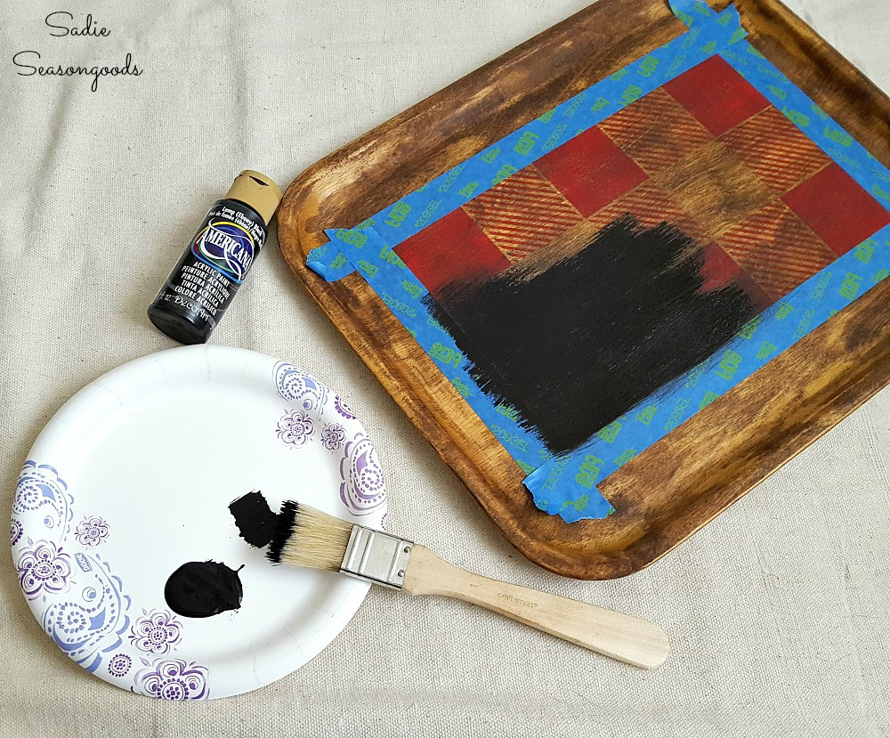 Painting over a Pinterest Fail with black craft paint to create the rustic cabin decor with a Buffalo plaid stencil