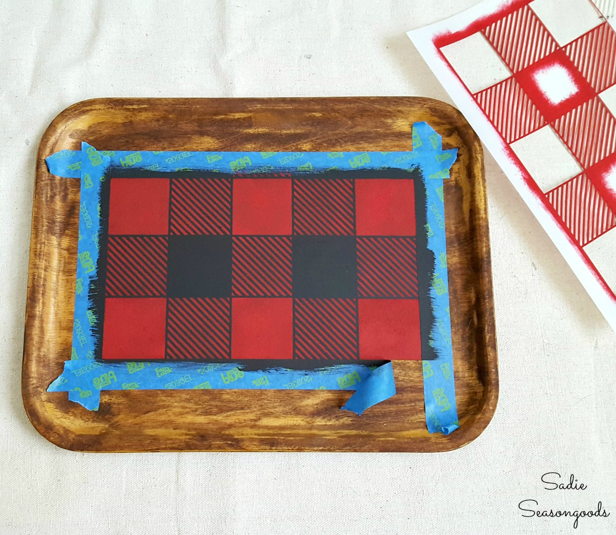 Using a Buffalo check stencil or Buffalo plaid stencil on a wooden tray to create the rustic cabin decor