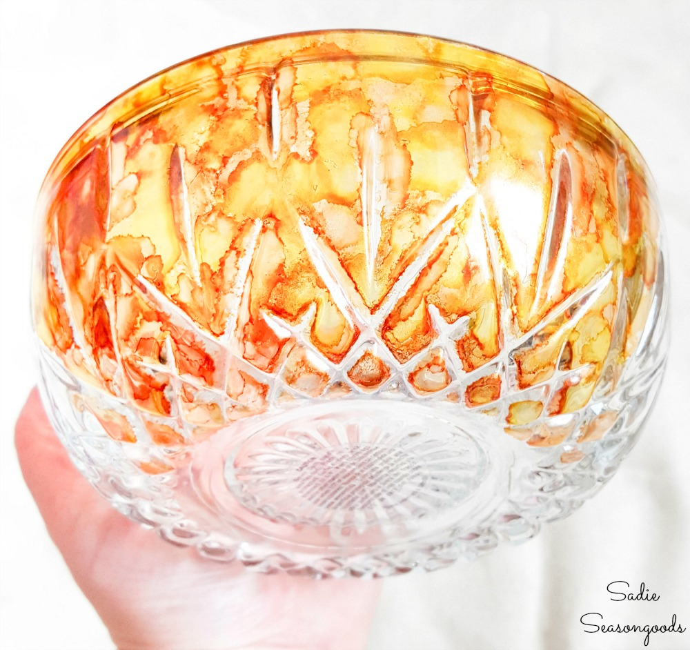 Alcohol paint in fall colors on clear glass pumpkins
