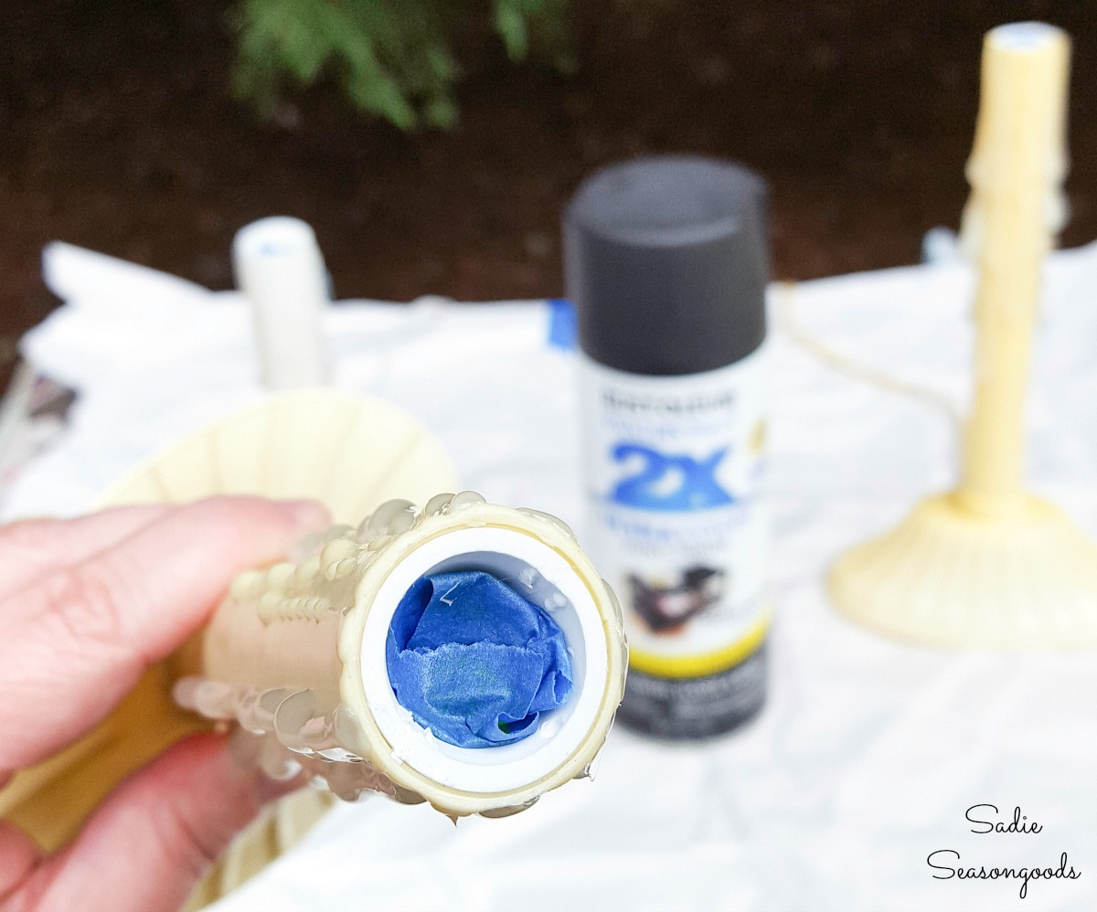 Spray painting the Electric Christmas Candles with black paint