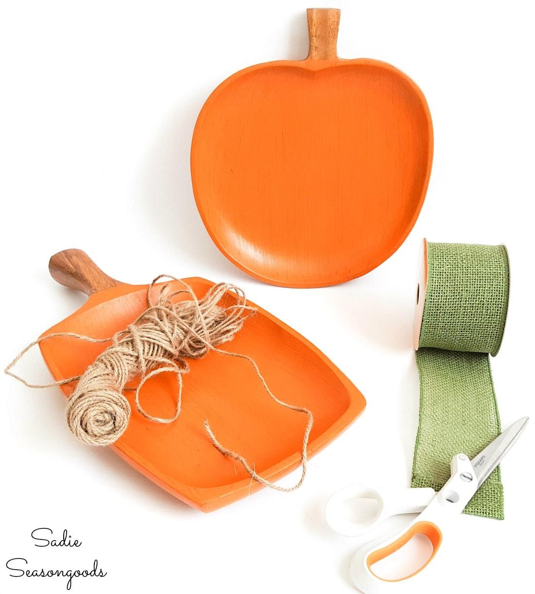 burlap ribbon and jute twine on wooden pumpkins