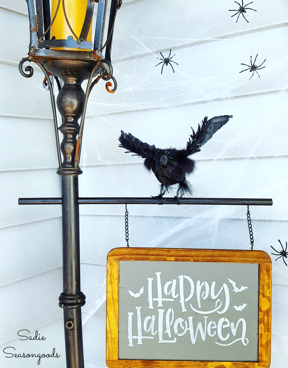 Halloween porch decorations with a Halloween sign on a small chalkboard for Hitchcock style decor
