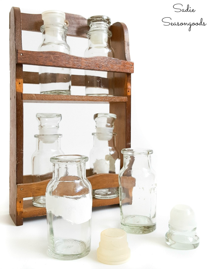 Upcycling a spice rack as Halloween potion bottles