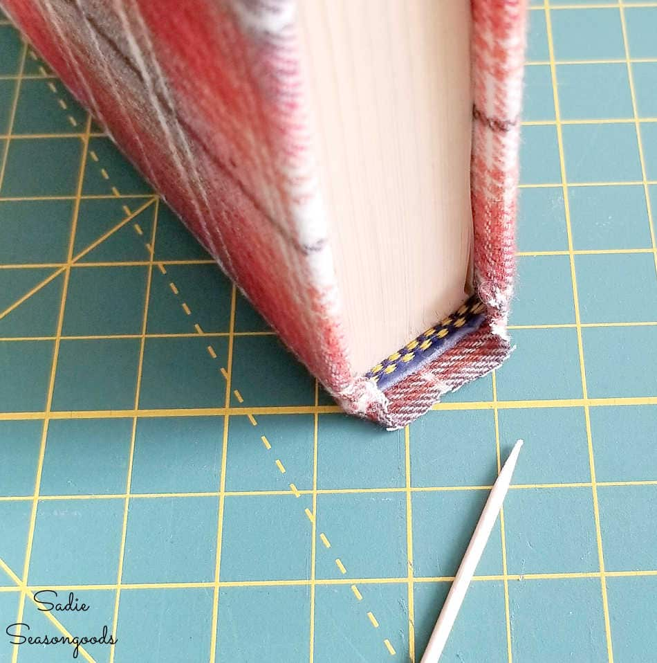 covering the spine of books with fabric