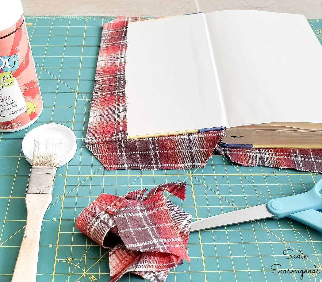 making the fabric book covers from thrift flannels