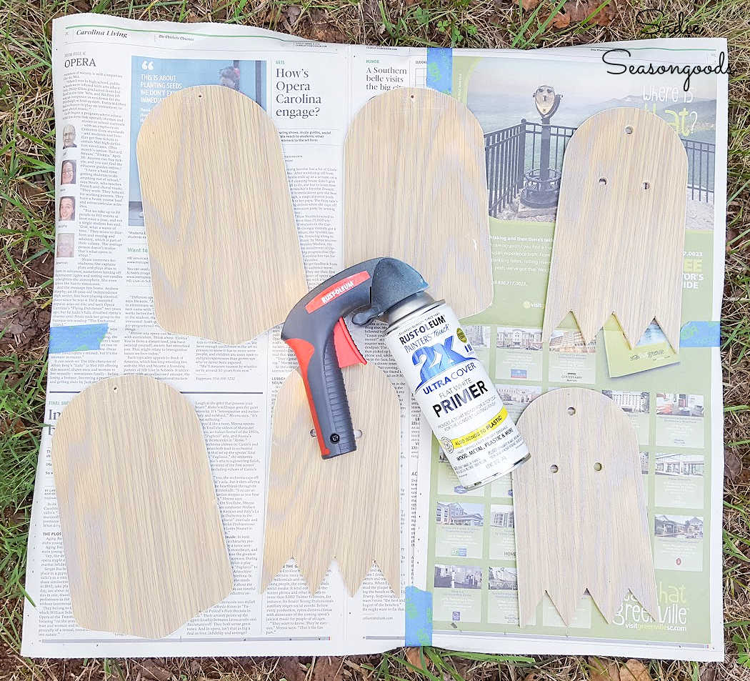 painting the outdoor ghost ornaments