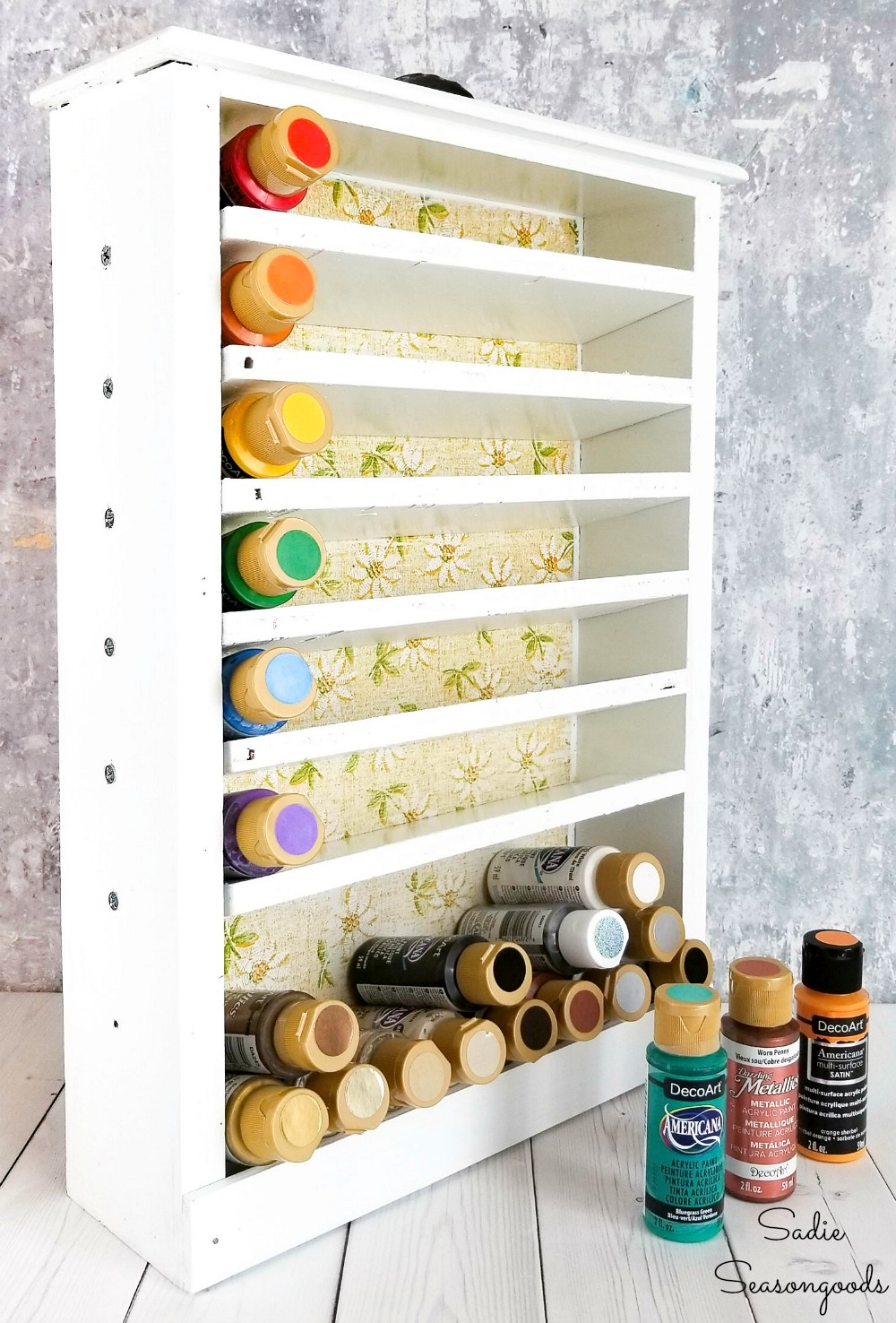 Acrylic paint storage rack in an old kitchen drawer
