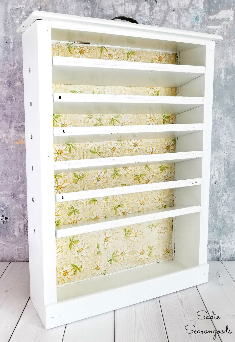 Craft paint organizer with beveled shelves
