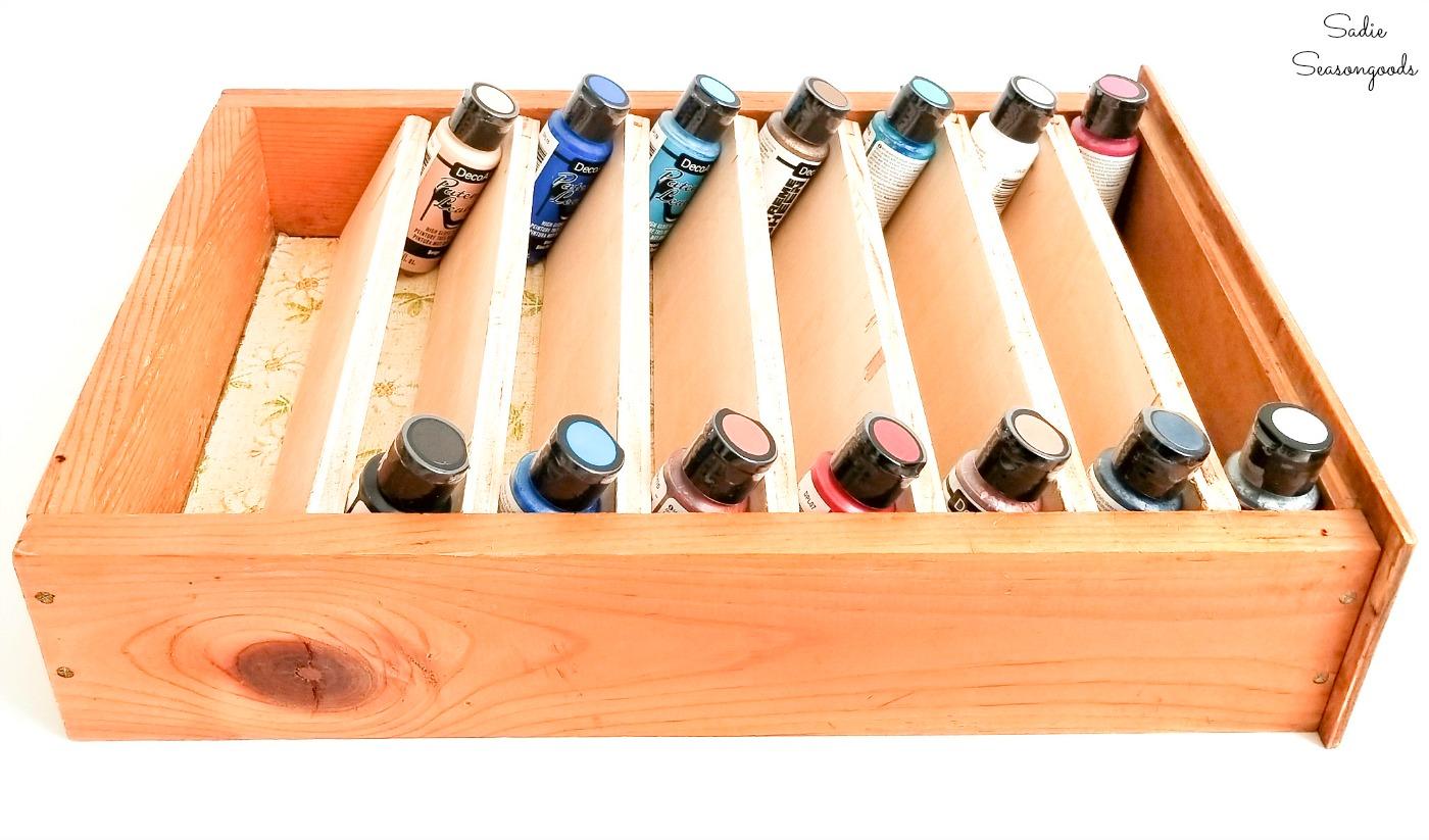 Craft paint storage in old kitchen drawers
