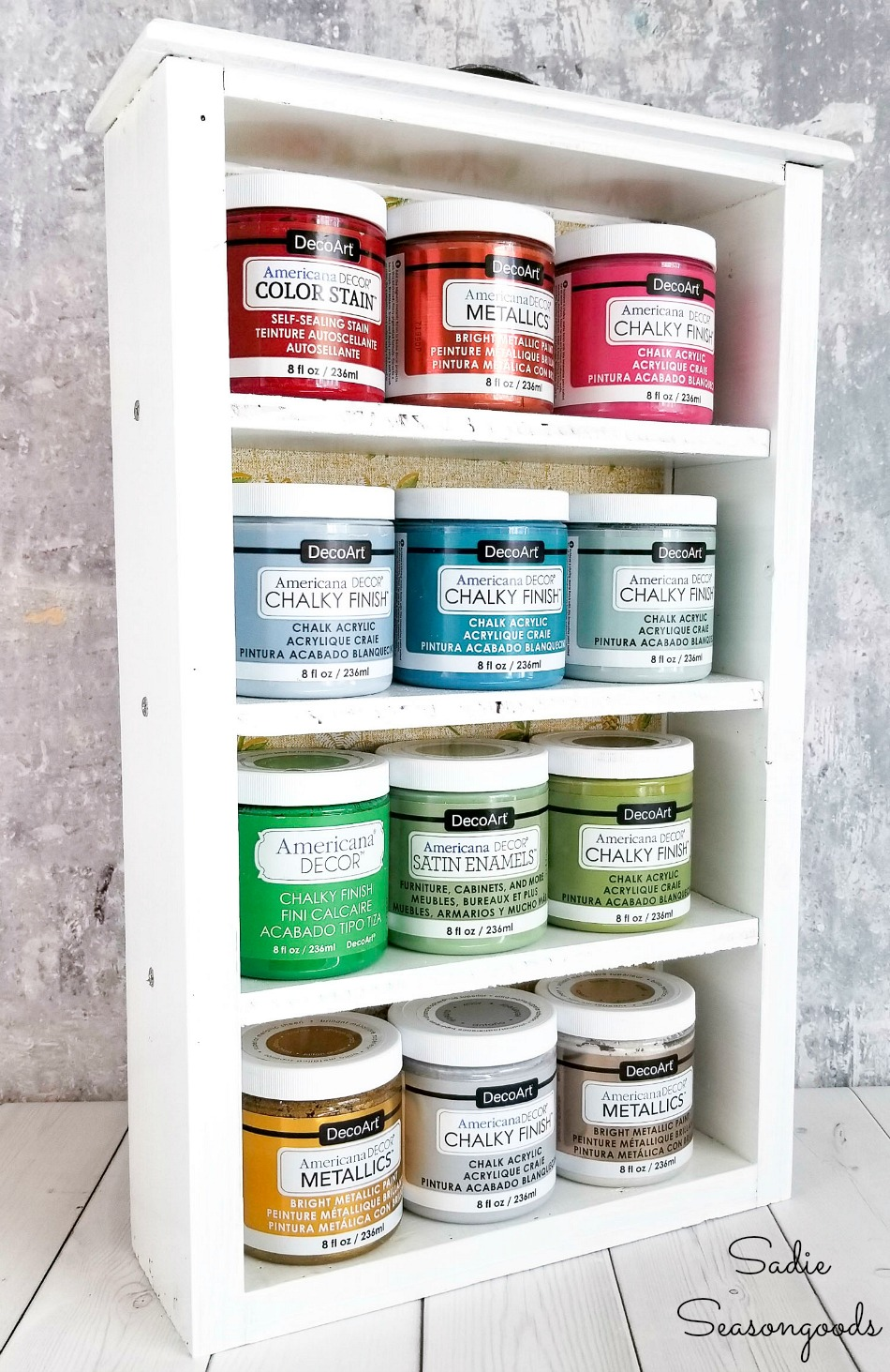 Craft room organization with an acrylic paint storage rack