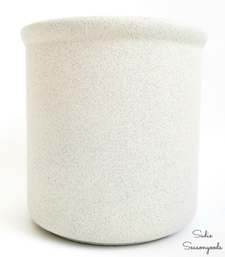Faux stone on a white ceramic canister to look like a stoneware crock