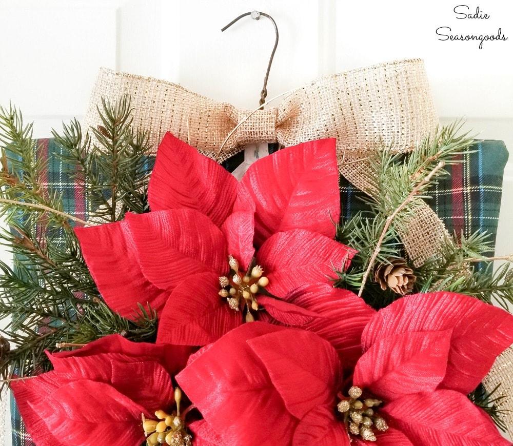 Burlap bow on a rustic Christmas wreath