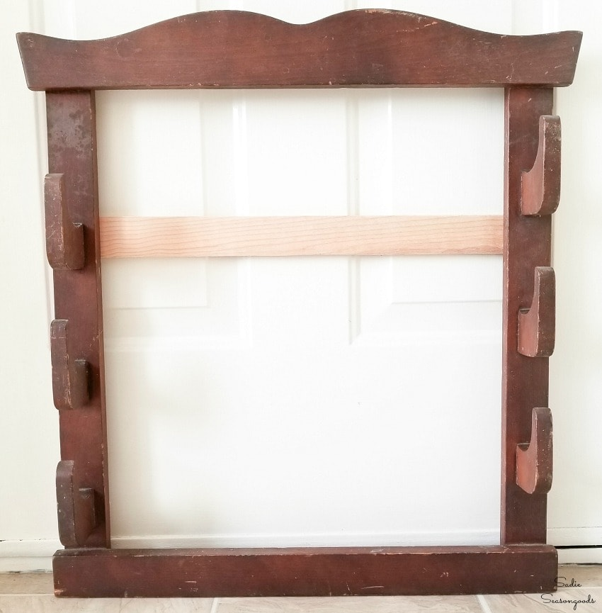 Upcycling a gun rack into entryway hooks