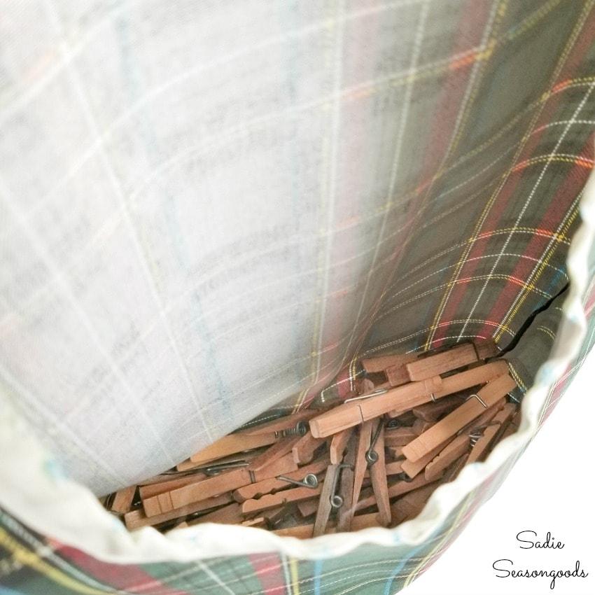 Vintage clothespins inside a peg bag