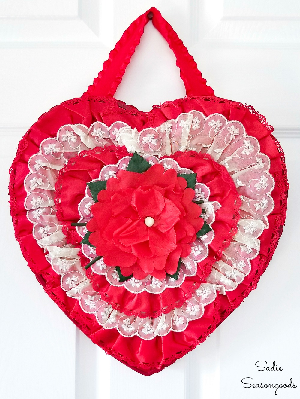 Chocolate heart box that has been upcycled into a heart shaped wreath for Valentine's Day home decor