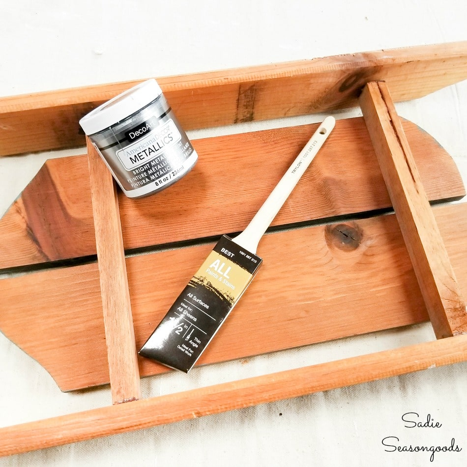 Painting the rails on wooden sled decor