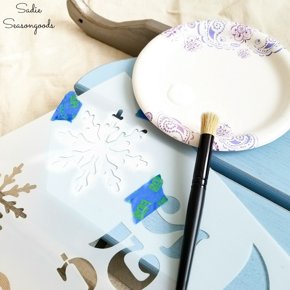 Snowflake stencil on wooden sled decor