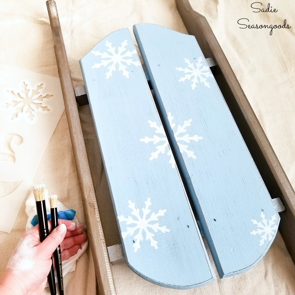Stenciling a decorative wooden sled