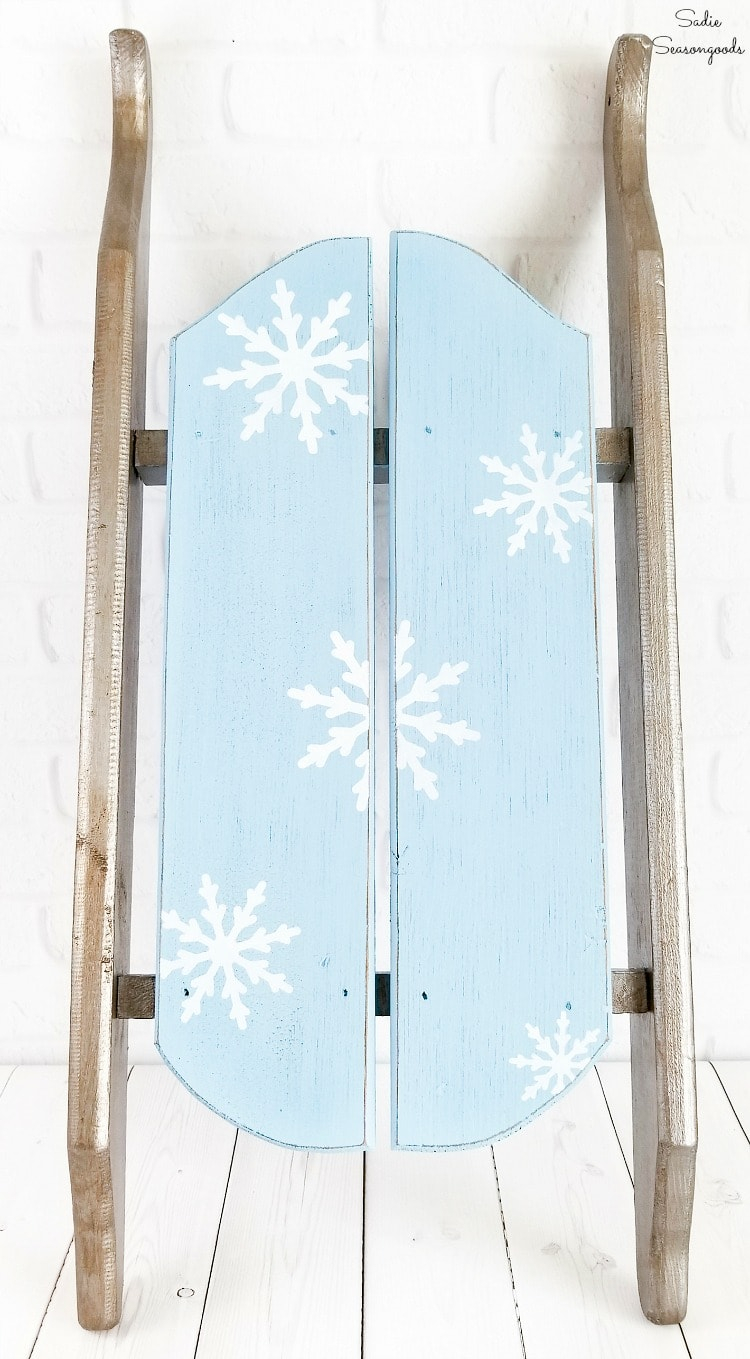 Using a winter stencil on a decorative sled