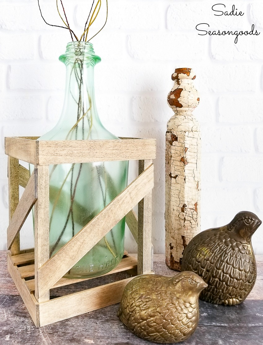 Empty wine bottles for glass bottle crafts by making a demijohn vase