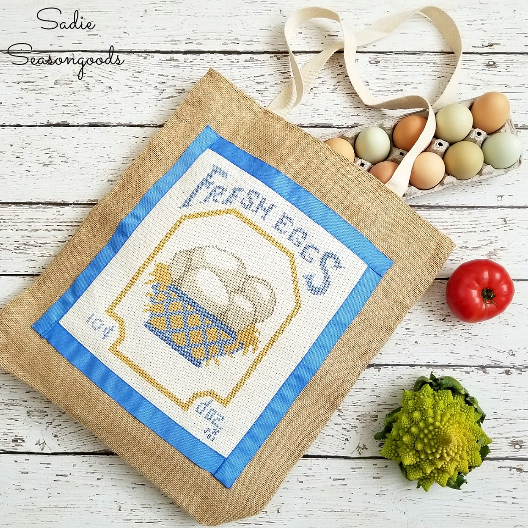 How to repurpose a framed cross stitch or counted cross stitch into a reusable shopping bag or burlap bag by Sadie Seasongoods / www.sadieseasongoods.com