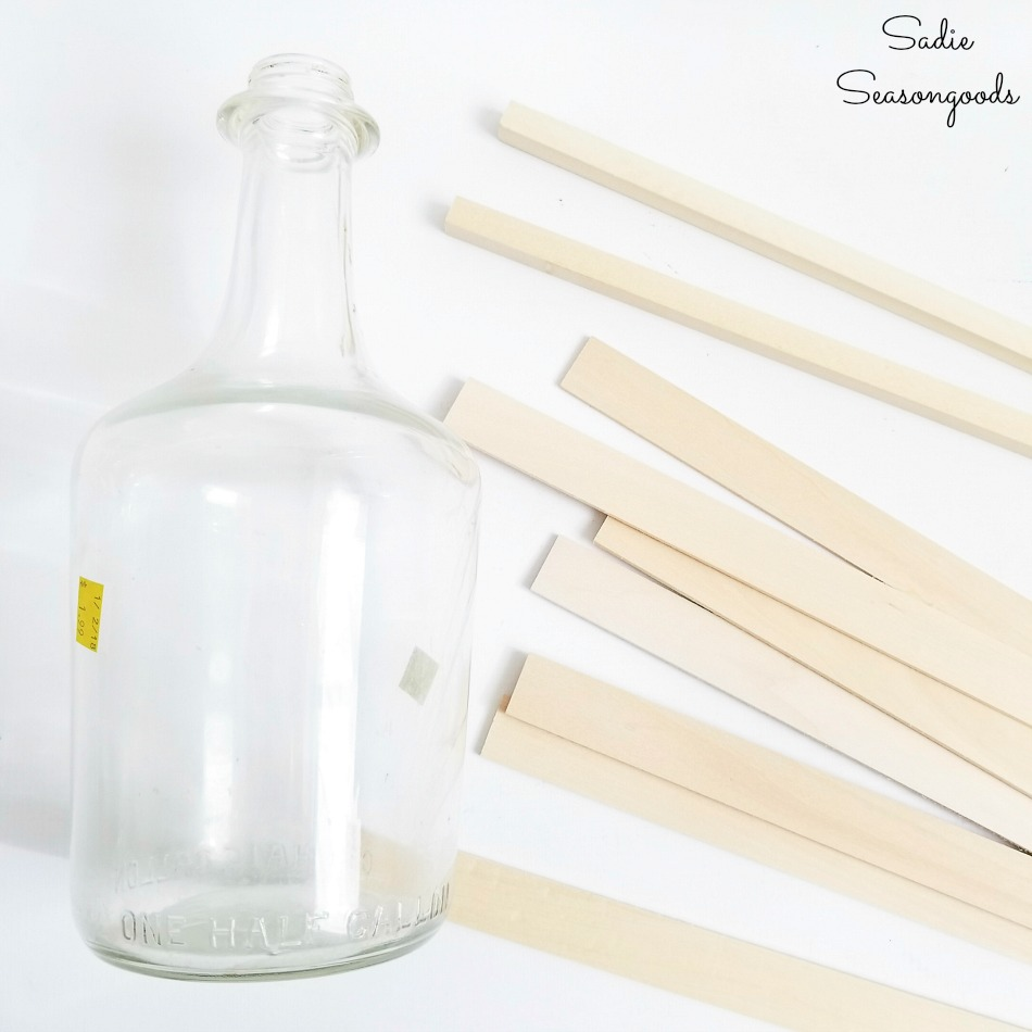 Upcycling the empty wine bottles into a glass demijohn with craft wood