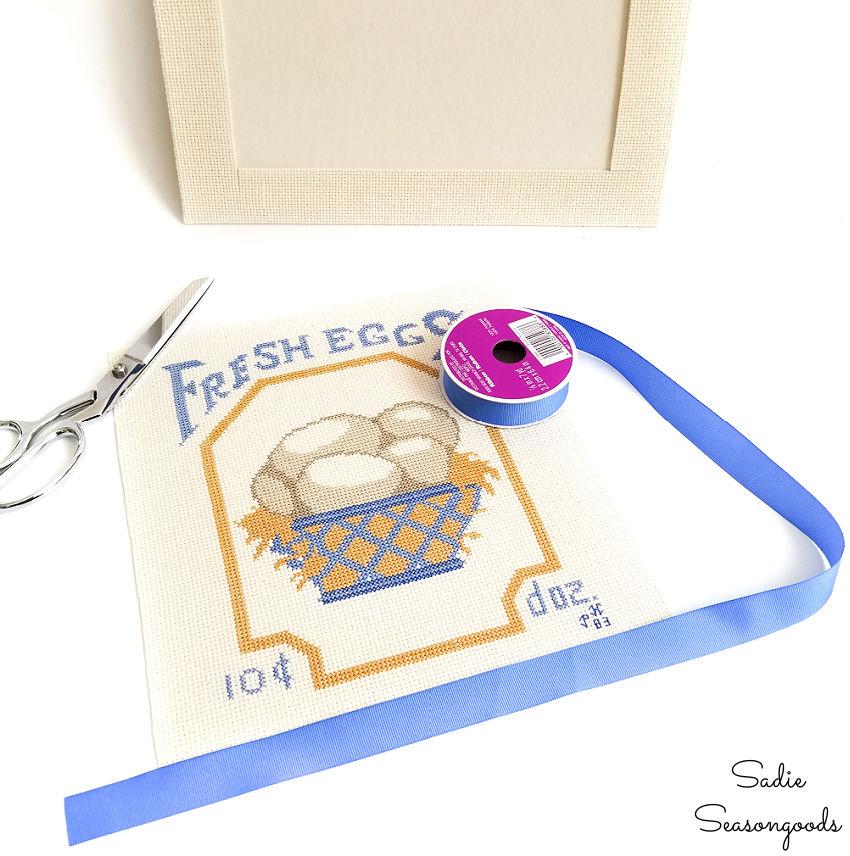 cutting out a framed cross stitch
