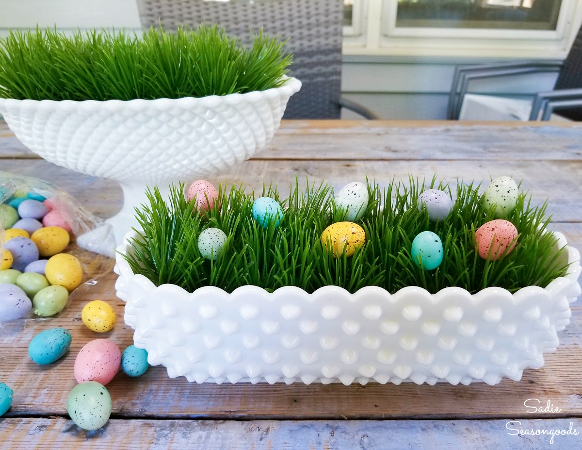 Speckled eggs on a plastic grass mat as Easter decoration ideas in milk glass dishes