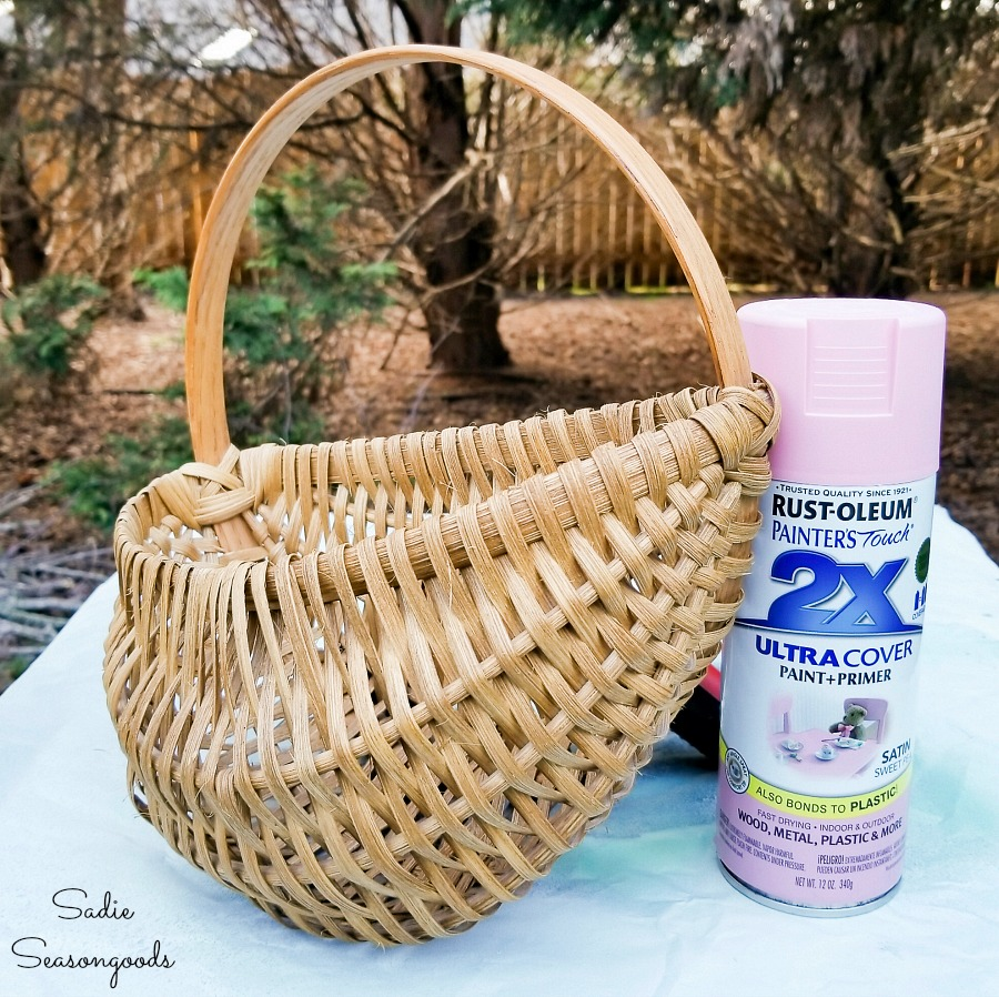 Spray painting a flat back basket for upcycling into an Easter Wreath DIY