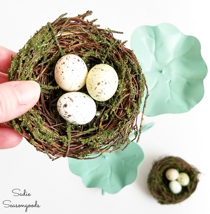 nest decor on a metal candle holder