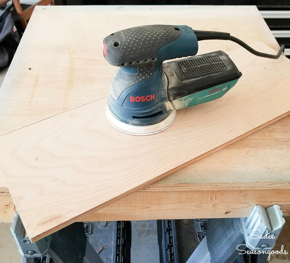 Bosch orbital sander on the plywood before applying the Weatherwood stains