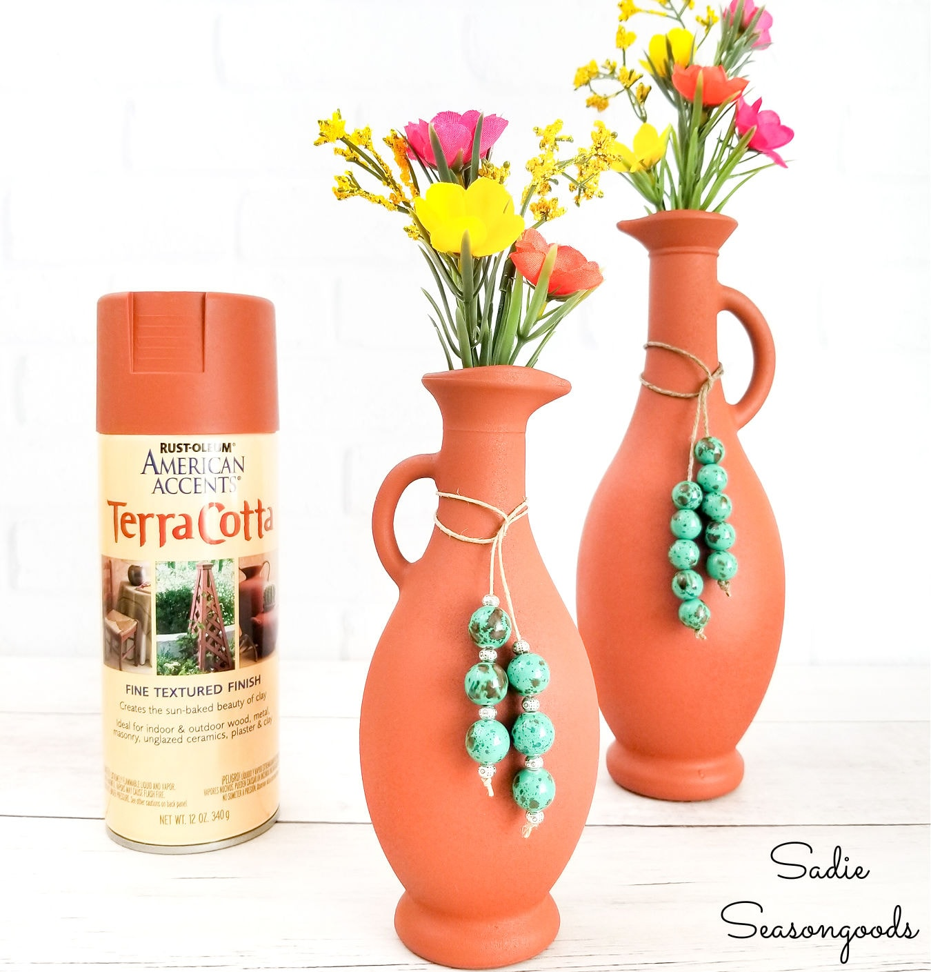spray painting glass vases with terracotta spray paint