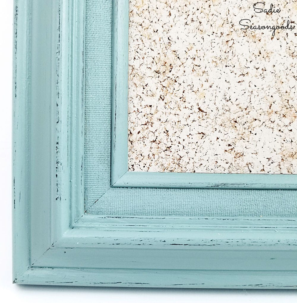 Decorative cork board with a picture frame