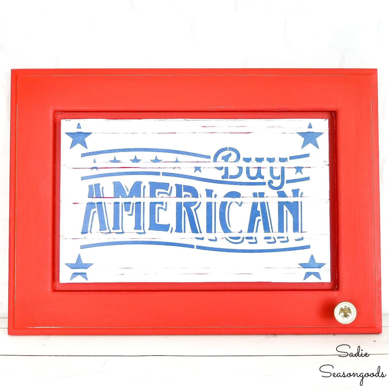 patriotic sign on a repurposed cabinet door