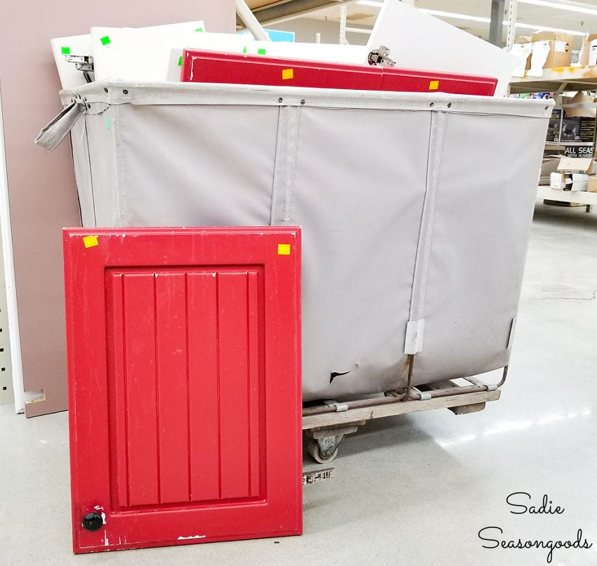 red cabinet door at Habitat ReStore