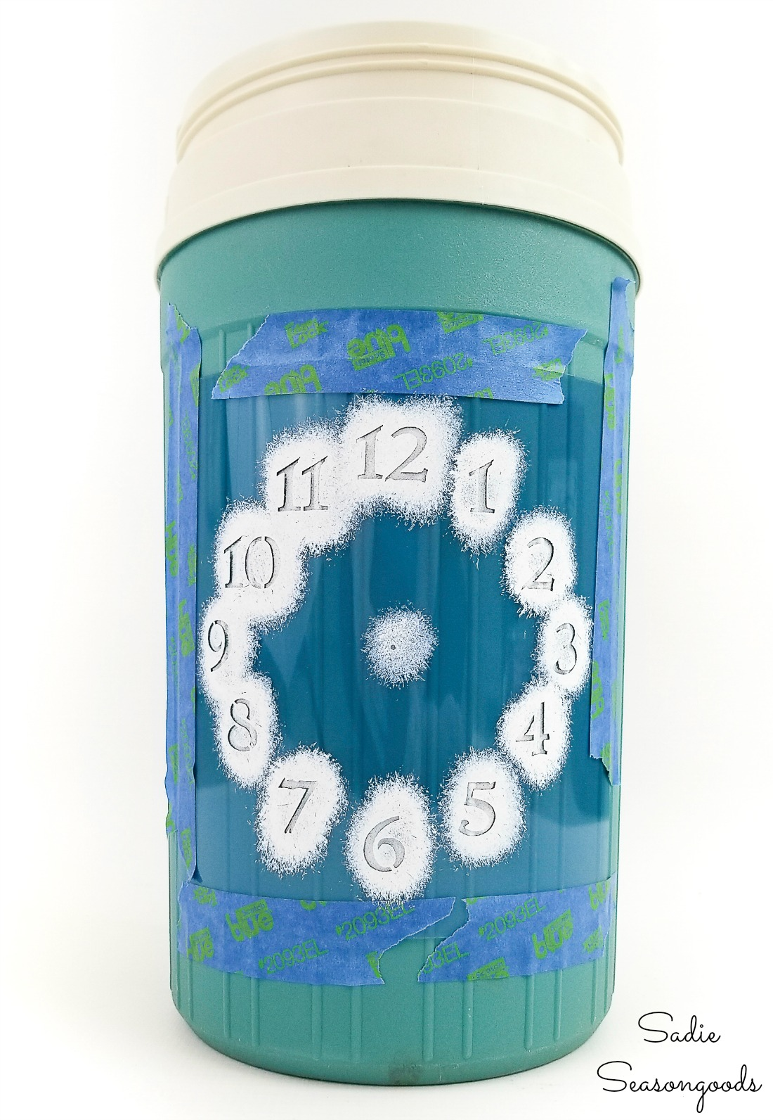 Happy hour decor with a clock stencil and a wine bottle cooler